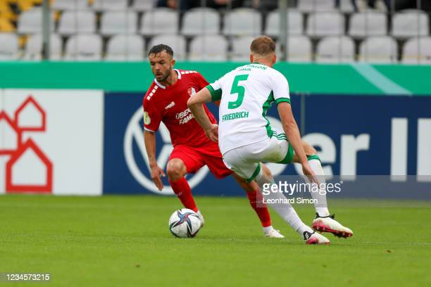 Albion Vrenezi of Türkgücü Munich and Marvin Friedrich of Union Berlin in action during the DFB Cup first round match between Türkgücü Munich and 1....