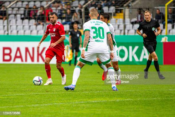 Albion Vrenezi of Türkgücü Munich and Robert Andrich of Union Berlin in action during the DFB Cup first round match between Türkgücü Munich and 1. FC...
