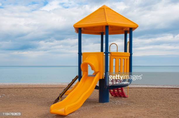 albir beach - slide play equipment stock pictures, royalty-free photos & images