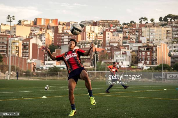 Albirex Niigata player kicks the ball during a training session at the Vall d'Hebron training grounds on October 28 2013 in Barcelona Spain FC...