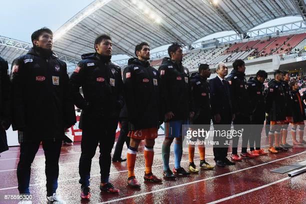 Albirex Niigata players applaud supporters after their relegation to the J2 despite their 10 victory in the JLeague J1 match between Albirex Niigata...