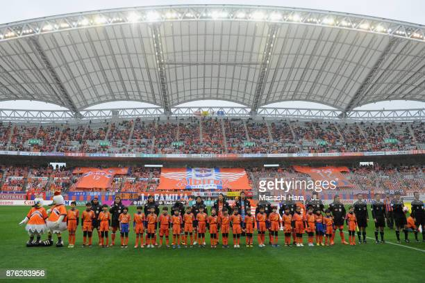 Albirex Niigata players line up for the team photos prior to the JLeague J1 match between Albirex Niigata and Ventforet Kofu at Denka Big Swan...
