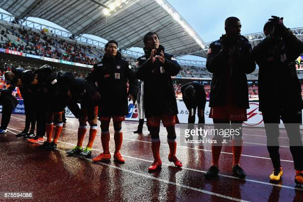 Albirex Niigata players show dejection after their relegation to the J2 despite their 10 victory in the JLeague J1 match between Albirex Niigata and...
