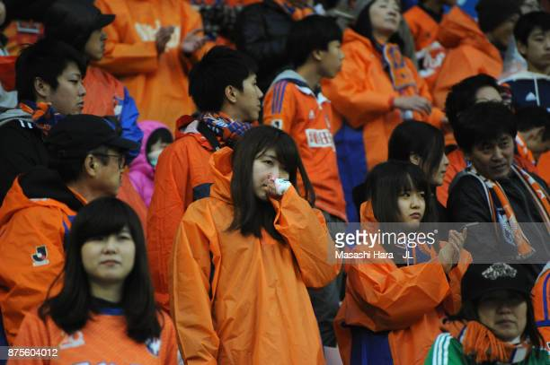 Albirex Niigata supporters show dejection after their team's relegation after the JLeague J1 match between Albirex Niigata and Ventforet Kofu at...