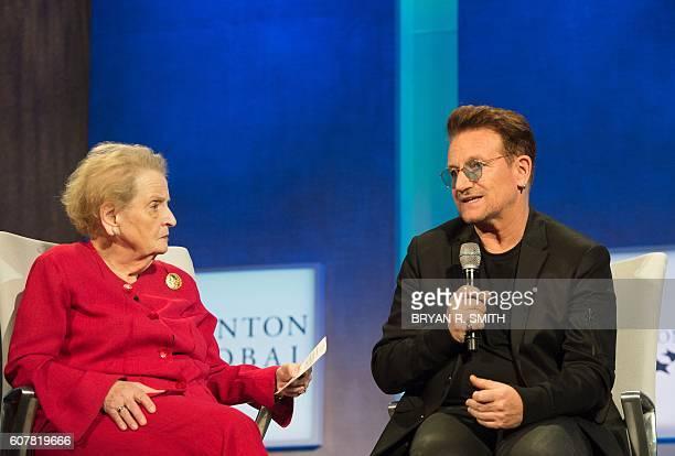 Albright Stonebridge Group Chair Madeline Albright listens as U2 lead singer Bono speaks at theOpening Plenary Session 'Partnering for Global...