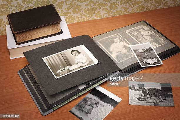 album with old photographs - childhood photo album stock photos and pictures