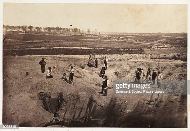 Albumen print of a group of tourists inspecting Confederate Army fortifications outside Petersburg Only two years after the American Civil War ended...
