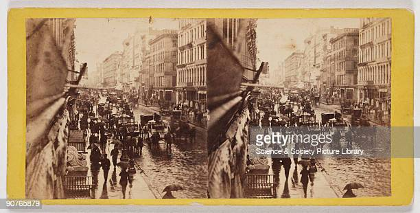 Albumen print Stereoscopic card by E H T Anthony of New York A busy street scene with pedestrians carrying umbrellas and traffic consisting of horses...