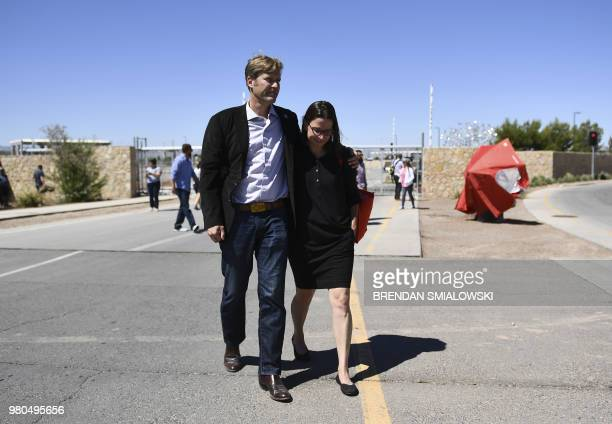 Albuquerque, New Mexico mayor Tim Keller walks with his wife after leaving some shoes and toys for immigrant children at the Tornillo Port of Entry...
