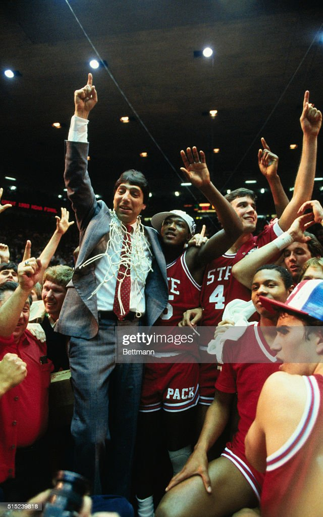 North Carolina State's coach Jim Valvano gives the #1 winning sign as he stand with his winning team at the NCAA Final Four championship game. North Carolina defeated Houston 54-52 in the championship game.