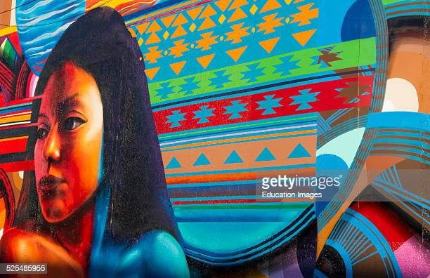 Albuquerque New Mexico Route 66 painted mural of Navajo American Indian girl with color off of Central Avenue artwork