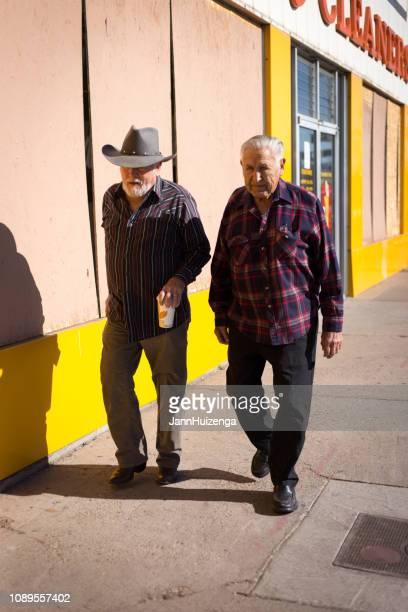Albuquerque, NM: Senior Men Walking in Nob Hill Neighborhood