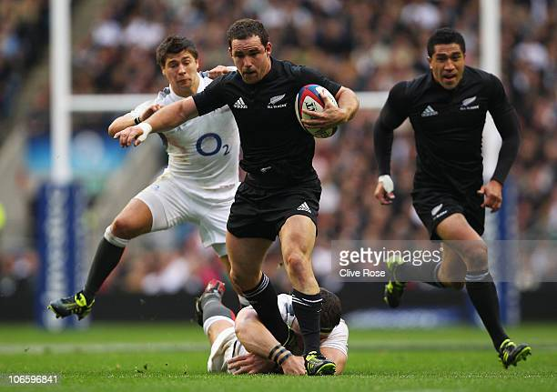 Alby Mathewson of New Zealand is tackled by Ben Youngs and Andrew Sheridan of England during the Investec Challenge match between England and New...