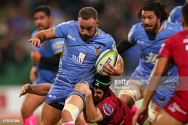 Alby Mathewson of the Force attempts to break from a tackle by Liam Gill of the Reds during the round 16 Super Rugby match between the Western Force...