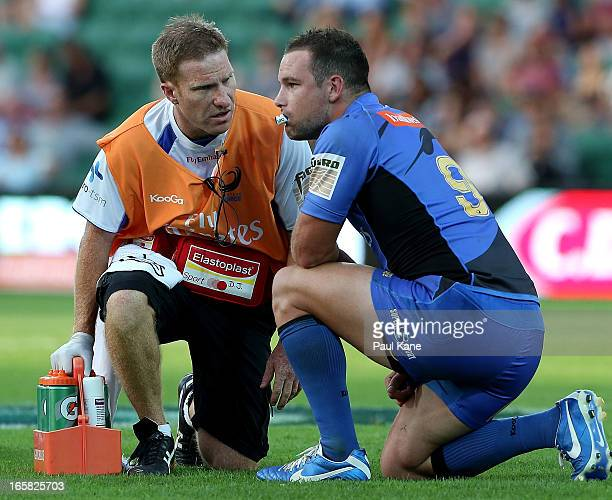 Alby Mathewson of the Force is checked by a trainer during the round eight Super Rugby match between the Western Force and the Melbourne Rebels at...