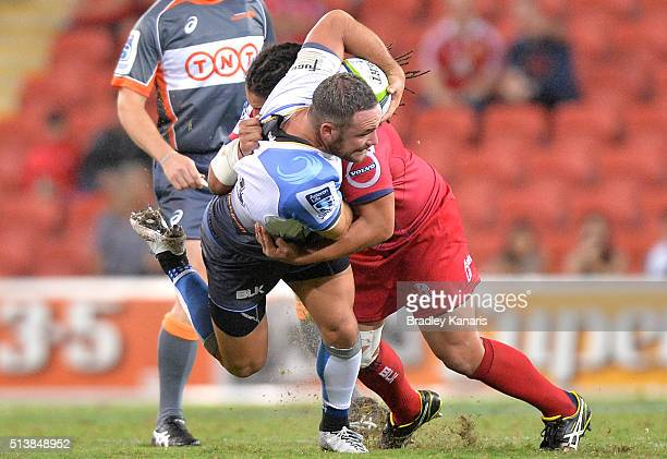 Alby Mathewson of the Force is tackled during the round two Super Rugby match between the Reds and the Force at Suncorp Stadium on March 5 2016 in...