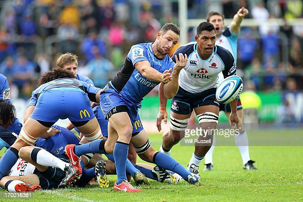 Alby Mathewson of the Western Force offloads the ball from the scrum during the round 17 Super Rugby match between the Force and the Waratahs at nib...