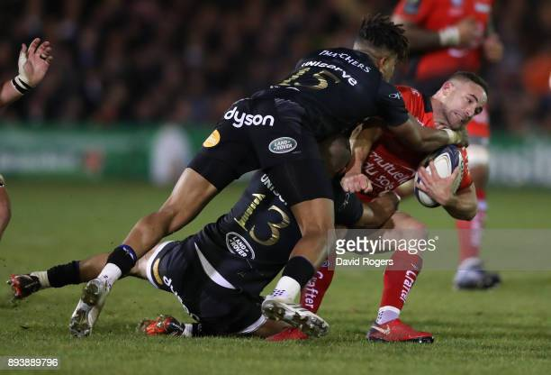 Alby Mathewson of Toulon is tackled by Jonathan Joseph and Anthony Watson during the European Rugby Champions Cup match between Bath Rugby and RC...