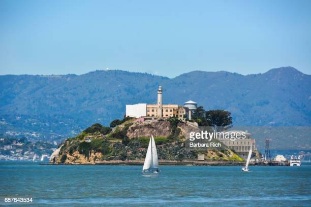 Alcatraz Island across the San Francisco Bay with sailboats on a beautiful spring day