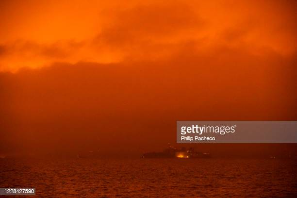 Alcatraz Island is barely visible as smoke from various wildfires burning across Northern California mixes with the marine layer, blanketing the San...