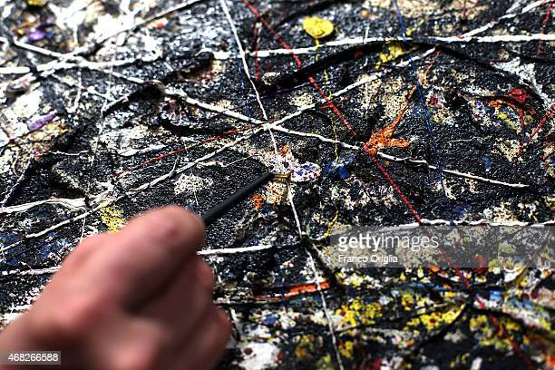 'Alchemy' by Jackson Pollock is restored at the Opificio delle Pietre Dure on January 26 2015 in Florence Italy The restored painting regarded as one...
