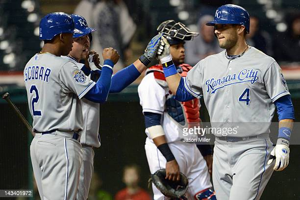 Alcides Escobar and Billy Butler celebrate with Alex Gordon of the Kansas City Royals after Gordon hit a threerun home run during the ninth inning...