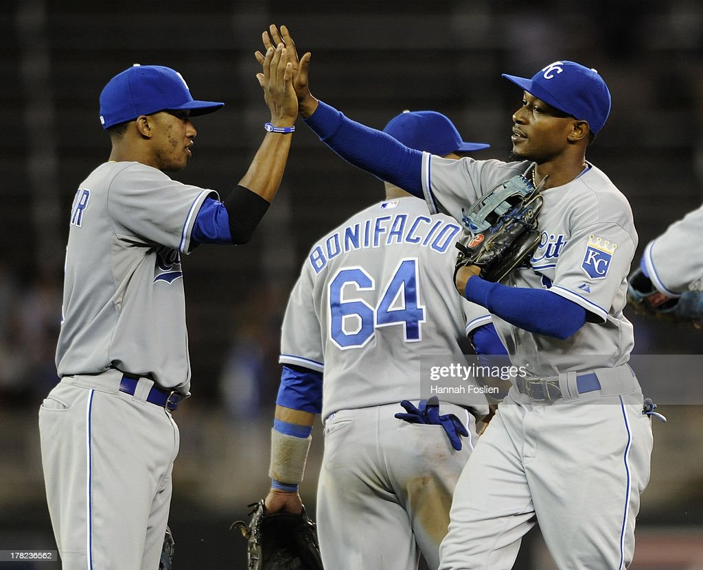 Alcides Escobar #2 and Jarrod Dyson #1 of the Kansas City Royals celebrate a win of the game against the Minnesota Twins on August 27, 2013 at Target Field in Minneapolis, Minnesota. The Royals defeated the Twins 6-1.