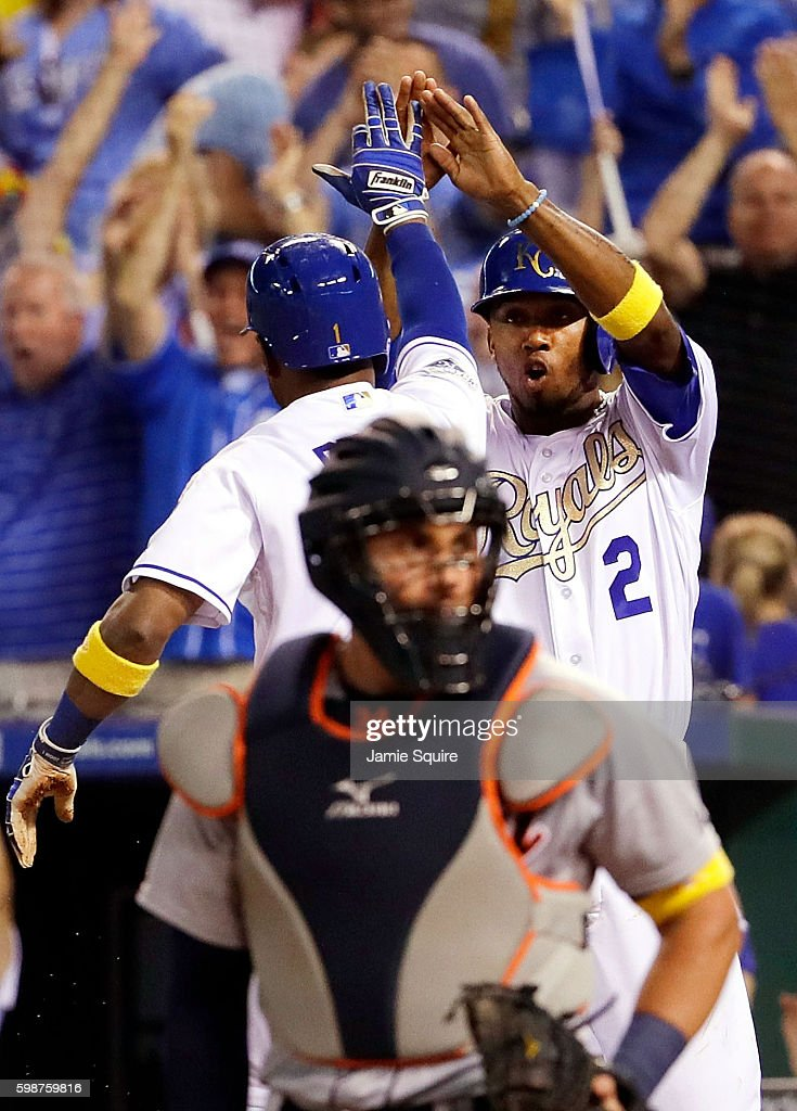 Alcides Escobar #2 and Jarrod Dyson #1 of the Kansas City Royals celebrate after Dyson scored during the 9th inning of the game against the catcher James McCann #34 and the Detroit Tigers at Kauffman Stadium on September 2, 2016 in Kansas City, Missouri.