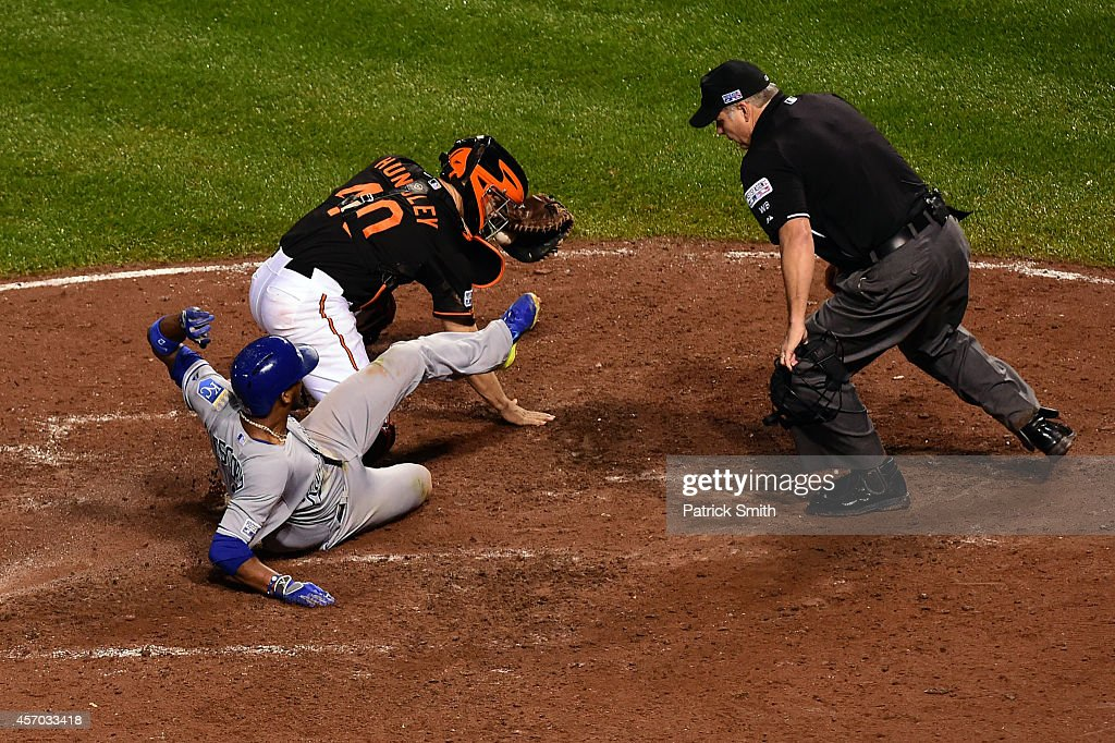 Alcides Escobar #2 gets tagged out by Nick Hundley #40 of the Baltimore Orioles on a grounded ball hit by Eric Hosmer #35 of the Kansas City Royals to first base in the ninth inning during Game One of the American League Championship Series at Oriole Park at Camden Yards on October 10, 2014 in Baltimore, Maryland.