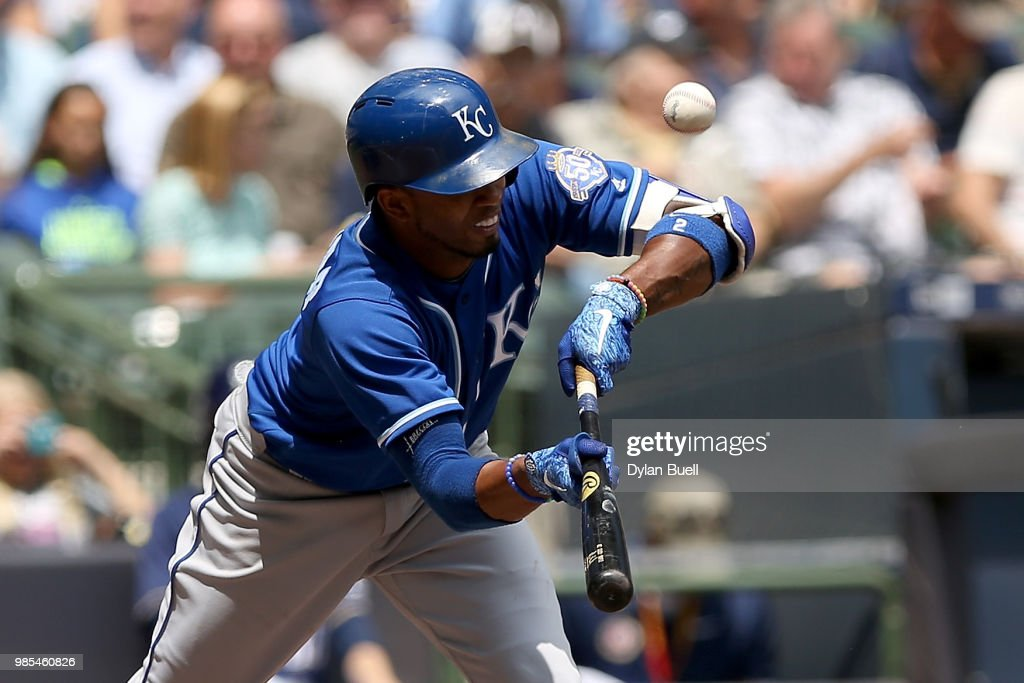 Alcides Escobar #2 of the Kansas City Royals attempts a bunt in the third inning against the Milwaukee Brewers at Miller Park on June 27, 2018 in Milwaukee, Wisconsin.