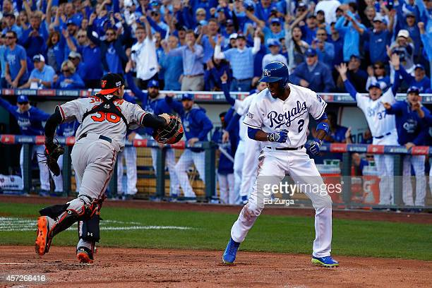 Alcides Escobar of the Kansas City Royals celebrates after scoing on Eric Hosmer of the Kansas City Royals grounder into fielder's choice to first...