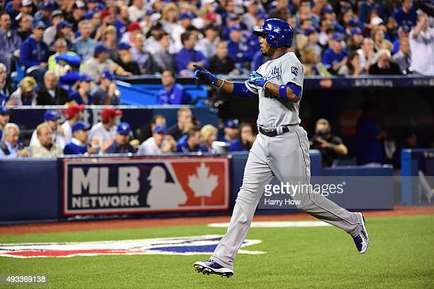 Alcides Escobar of the Kansas City Royals celebrates after scoring a run in the first inning against the Toronto Blue Jays during game three of the...