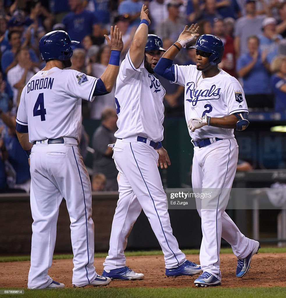 Alcides Escobar #2 of the Kansas City Royals celebrates his three-run home run with Alex Gordon #4 and Kendrys Morales #25 in the seventh inning against the New York Yankees at Kauffman Stadium on August 29, 2016 in Kansas City, Missouri.