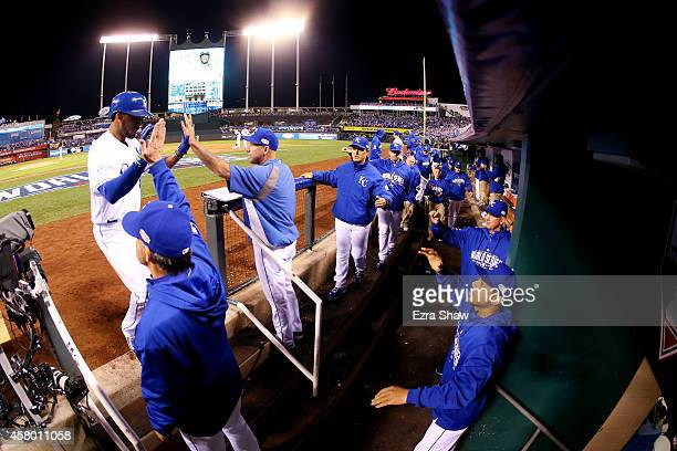 Alcides Escobar of the Kansas City Royals celebrates in the dugout after scoring in the second inning against the San Francisco Giants during Game...