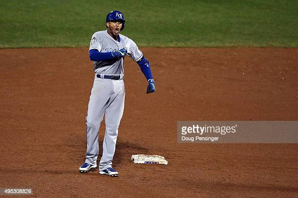 Alcides Escobar of the Kansas City Royals celebrates on second base after hitting a double to left field to score Christian Colon in the twelfth...