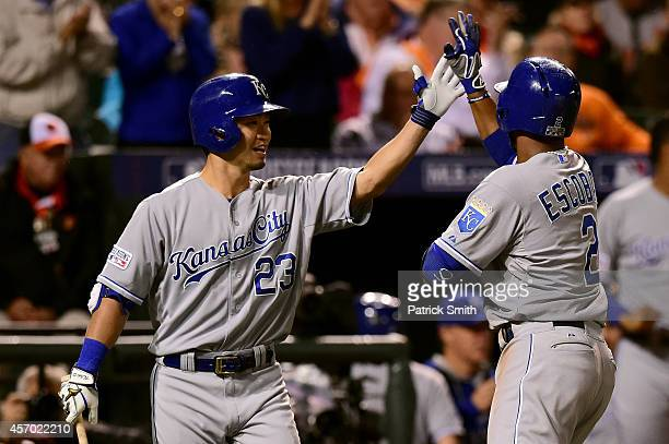 Alcides Escobar of the Kansas City Royals celebrates with teammate Norichika Aoki after hitting a solo home run to left field in the third inning...