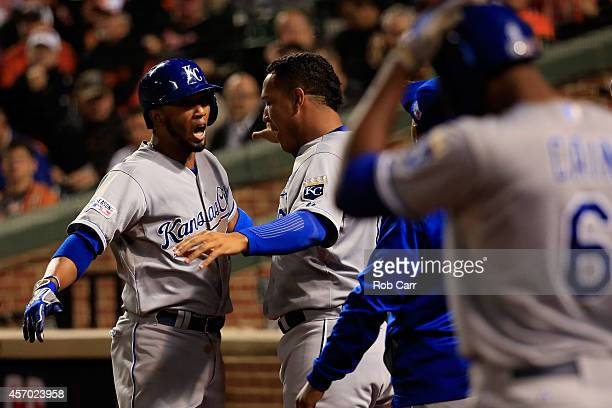 Alcides Escobar of the Kansas City Royals celebrates with teammate Salvador Perez after hitting a solo home run to left field in the third inning...