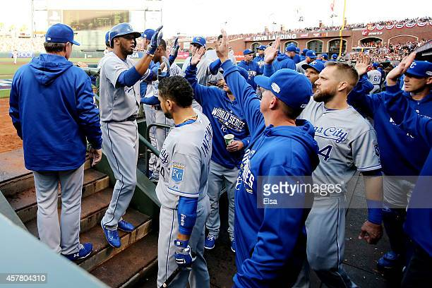 Alcides Escobar of the Kansas City Royals celebrates with teammates after scoring in the first inning against the San Francisco Giants during Game...