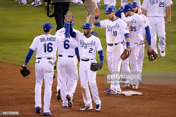 Alcides Escobar of the Kansas City Royals celebrates with teammates after defeating the New York Mets 71 in Game Two of the 2015 World Series at...