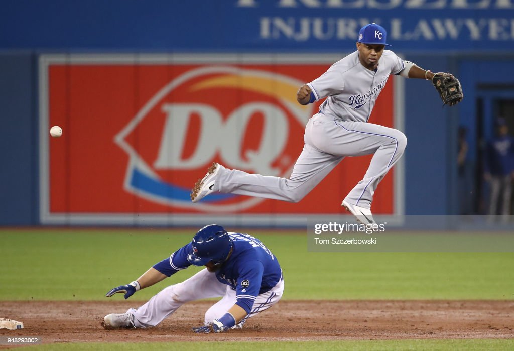 Alcides Escobar #2 of the Kansas City Royals commits an error by dropping the ball while trying to get the force out of Russell Martin #55 of the Toronto Blue Jays at second base in the third inning during MLB game action at Rogers Centre on April 18, 2018 in Toronto, Canada.