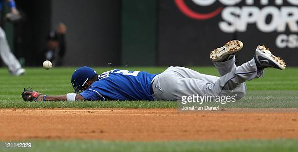 Alcides Escobar of the Kansas City Royals dives but misses a ball against the Chicago White Sox at US Cellular Field on August 14 2011 in Chicago...