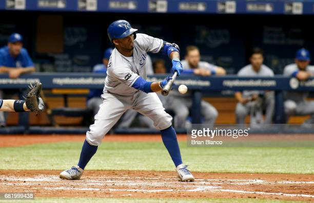 Alcides Escobar of the Kansas City Royals hits a sacrifice bunt to advance Cheslor Cuthbert during the fifth inning of a game against the Tampa Bay...