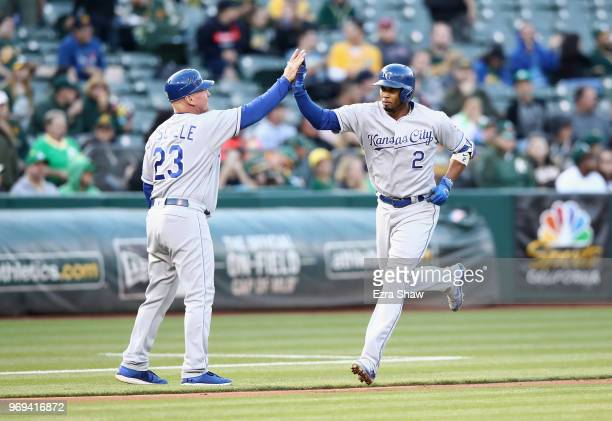 Alcides Escobar of the Kansas City Royals is congratulated by third base coach Mike Jirschele after he hit a home run in the third inning against the...
