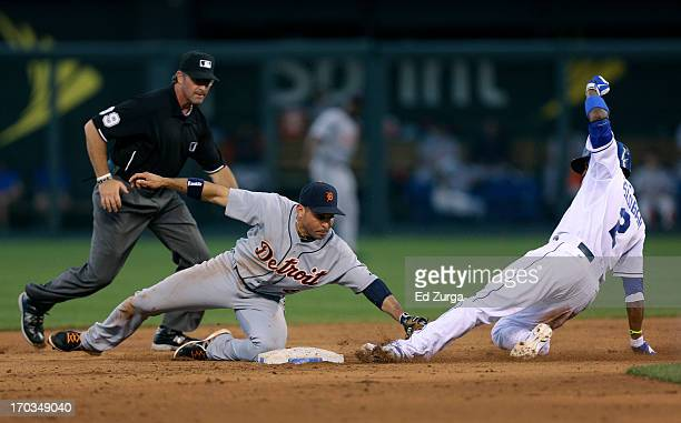 Alcides Escobar of the Kansas City Royals is tagged out by Omar Infante of the Detroit Tigers as he tries to stretch a double in the fifth inning at...