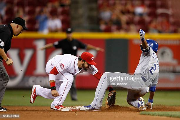 Alcides Escobar of the Kansas City Royals is tagged out trying to reach second base by Eugenio Suarez of the Cincinnati Reds in the 11th inning at...