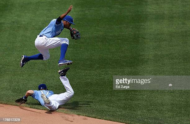 Alcides Escobar of the Kansas City Royals leaps over Chris Getz as they chase a hit by Justin Ruggiano of the Miami Marlins in the fourth inning at...