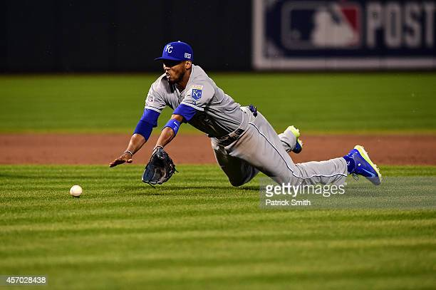 Alcides Escobar of the Kansas City Royals misses a infield single hit by Alejandro De Aza of the Baltimore Orioles scoring Jonathan Schoop to tie the...