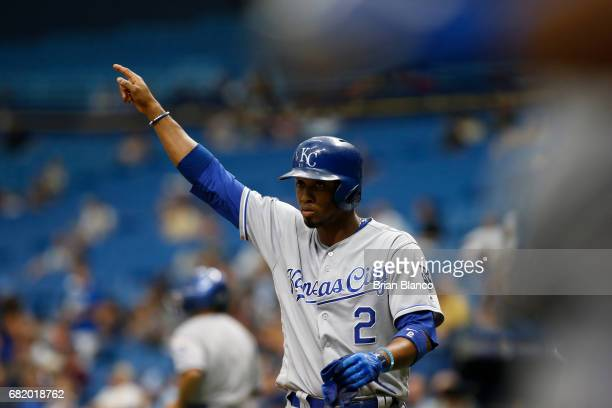 Alcides Escobar of the Kansas City Royals points back to second base toward Salvador Perez after scoring off of the tworun Rbi double by Perez during...