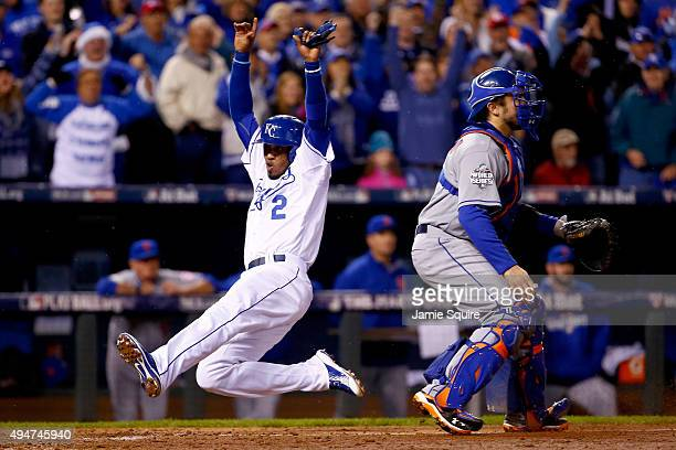 Alcides Escobar of the Kansas City Royals scores a run on a tworun RBI single hit by Eric Hosmer of the Kansas City Royals in the fifth inning...