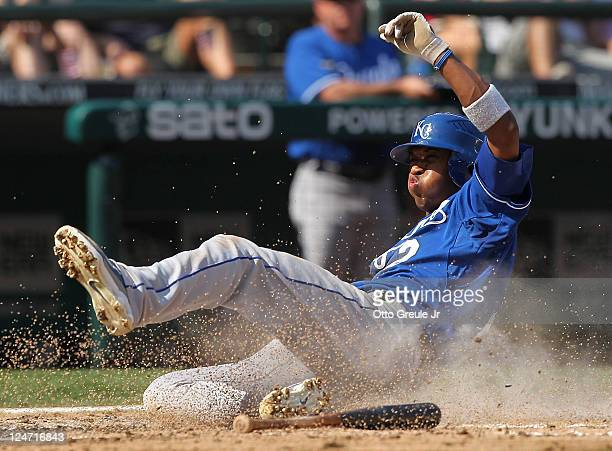 Alcides Escobar of the Kansas City Royals scores on an RBI double by Alex Gordon against the Seattle Mariners at Safeco Field on September 11 2011 in...
